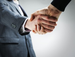 two-businessmen-shaking-hands-photo-F